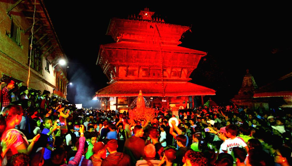 Devotees gather at Bagh Bhairav temple during Bagh Bhairav festival in Kirtipur, Kathmandu, Nepal, Aug. 18, 2015. Devotees offer prayers and make 108 rounds of ...