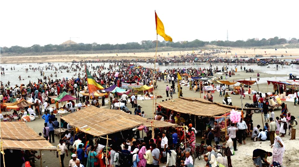 Devotees gather to take a holy dip in Triveni Sangam on the occasion of Ganga Dussehra, in Allahabad on May 24, 2018.
