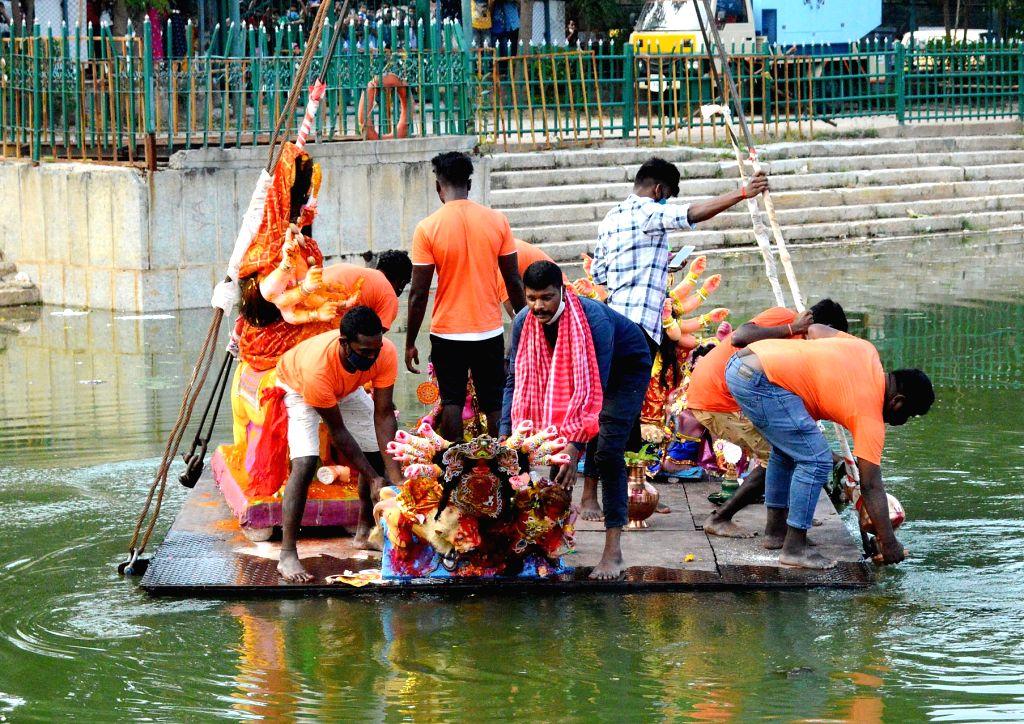 Devotees immerse idols of Goddess Durga at Ulsoor lake on Vijayadashami, in Bengaluru on Oct 26, 2020.
