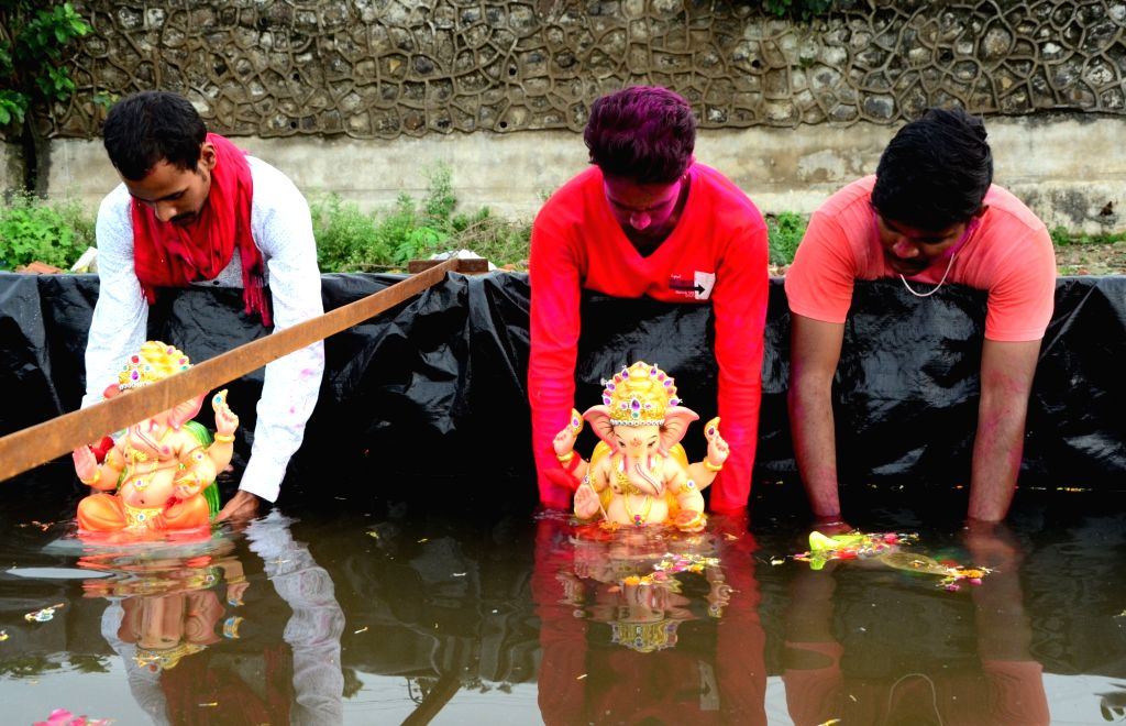 Devotees immerse the idols of Lord Ganesha in water on Anant Chaturdashi or the last day of Ganesh Chaturthi, in Nagpur on Sep 1, 2020.