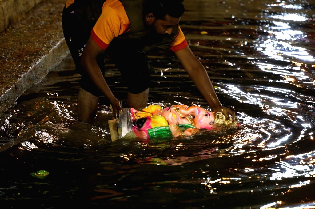 Devotees immersing the Lord Ganesha Idols at Ulsoor Lake on the ocaasion of Gowri Ganesha Festival celebration, in Bengaluru on Sep 3, 2019.