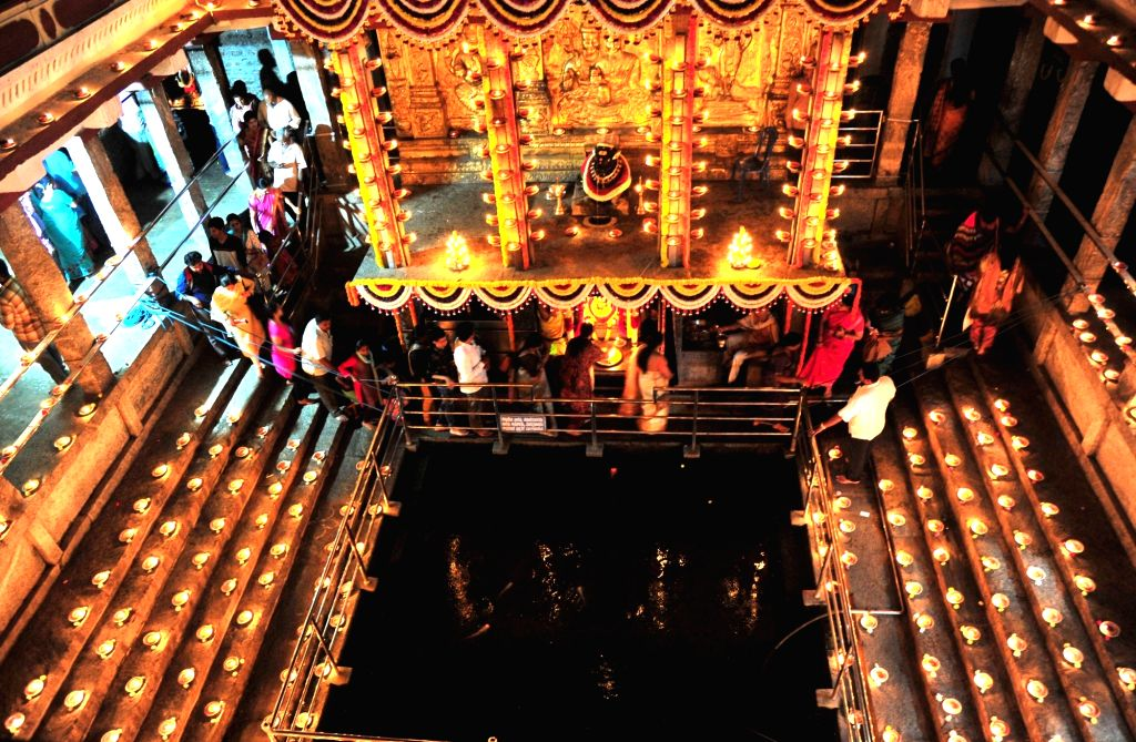 Devotees lights the lamps to celebrate Laksha Deepotsava, on the occasion of last Monday of Karthika month at Kadu Malleshwara Temple, in Bengaluru on Nov 25, 2019.