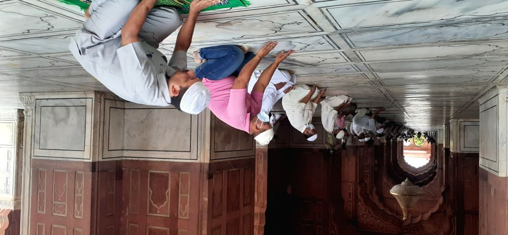 Devotees offer prayers at Delhi's Jama Masjid maintaining social distancing norms after the mosque which was closed as a precautionary measure to contain the spread of COVID-19, reopened ...