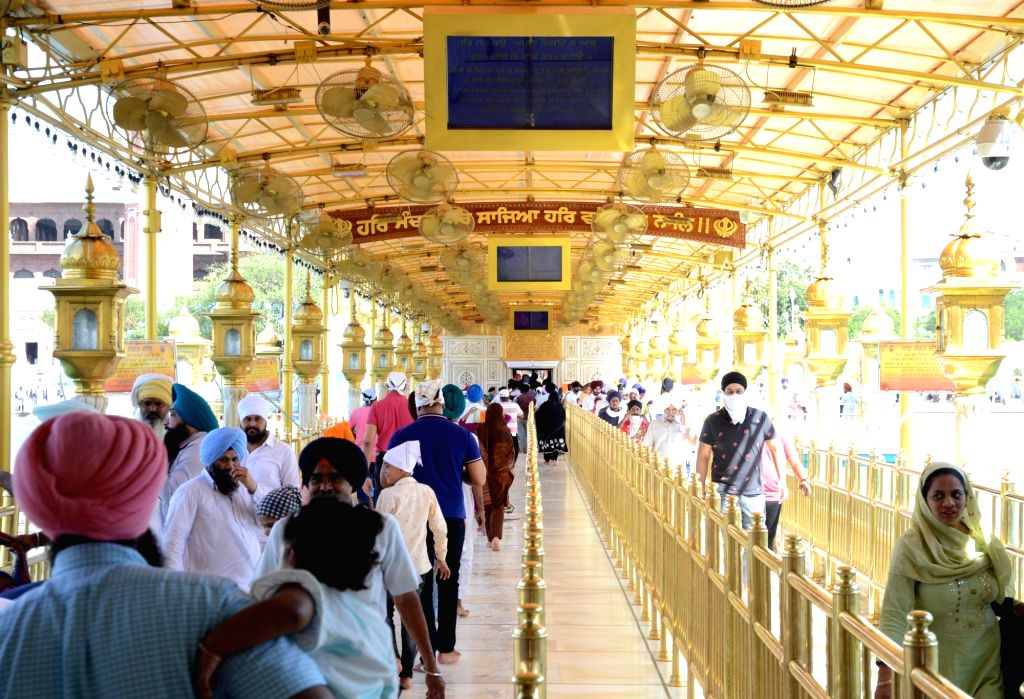 Devotees offer prayers at  Golden Temple on the birth anniversary of Guru Amar Das third of the Ten Gurus of Sikhism in Amritsar, Tuesday, May 25, 2021.