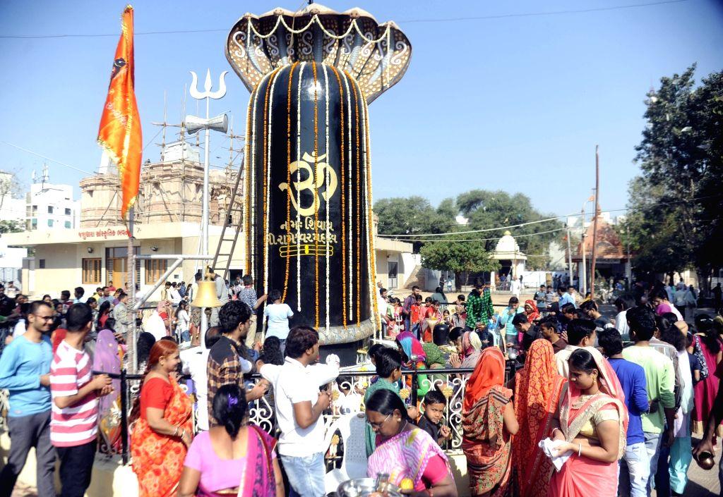 Devotees offer prayers at Mahadev temple on the occasion of Maha Shivaratri in Ahmedabad on Feb 13, 2018.