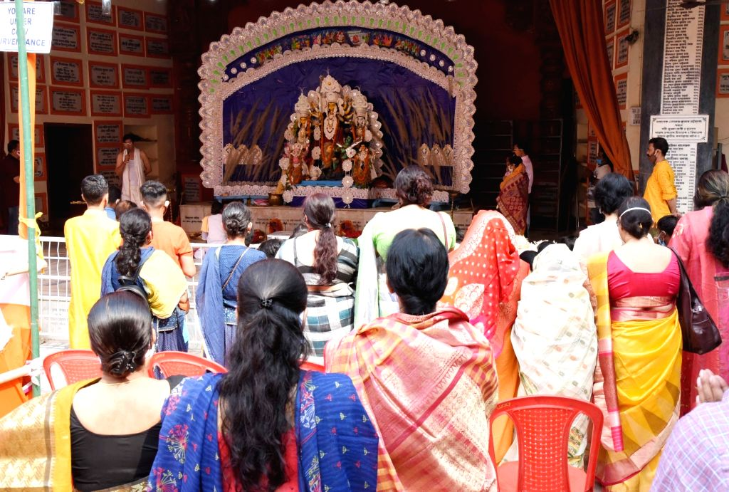 Devotees offer prayers during Maha Ashtami puja at Bengali Akhara in Patna on Oct 24, 2020.