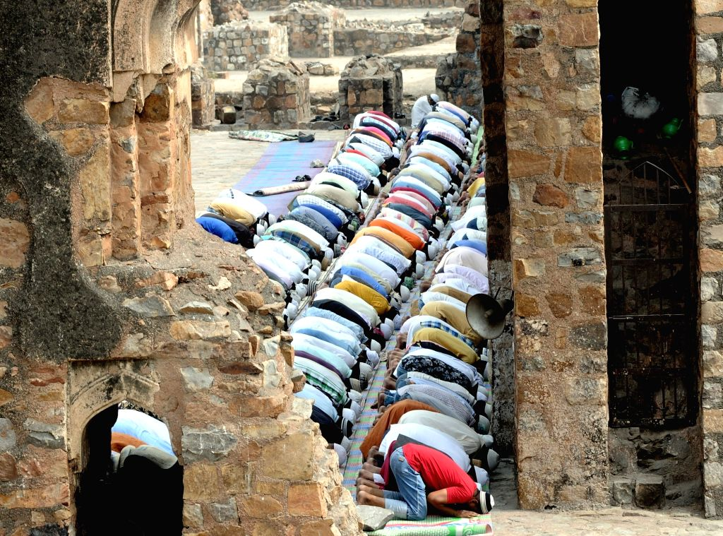 Devotees offer prayers on the first Friday of Ramadan at Jami Masjid of Feroz Shah Kotla fortress in New Delhi, on May 10, 2019. - Feroz Shah Kotla