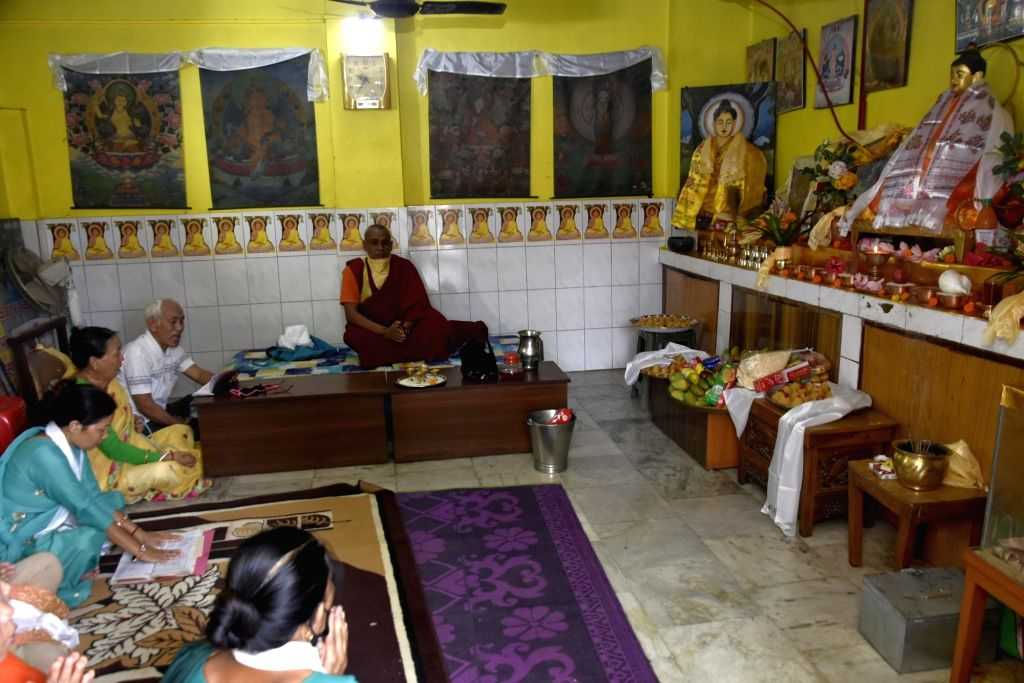Devotees offer prayers to Lord Buddha on Buddha Purnima at a monastery in Ranchi durng the extended nationwide lockdown imposed to mitigate the spread of coronavirus on May 7, 2020.