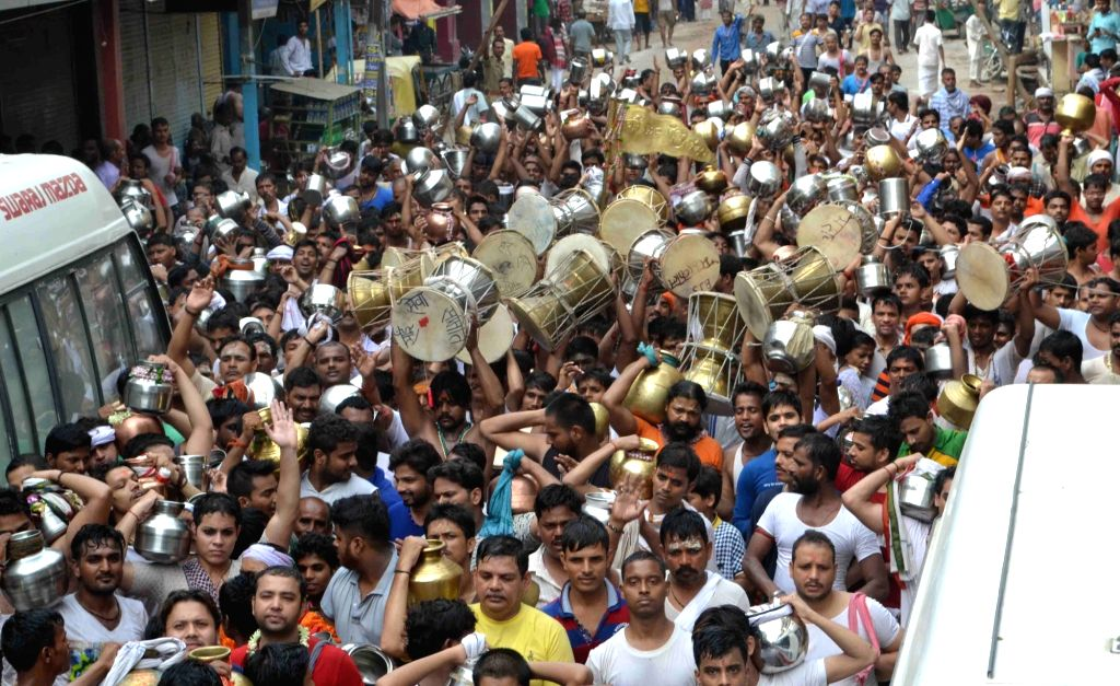 Devotees on the way for the Jalabishek at Kashiviswanath Temple on the first monday of the Shravan month in Varanasi on July 25, 2016.