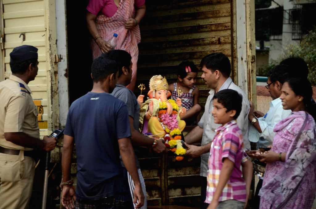 Devotees participate during the Lord Ganesh idol immersion rally at Dadar Sea in Mumbai on Aug. 30, 2014.