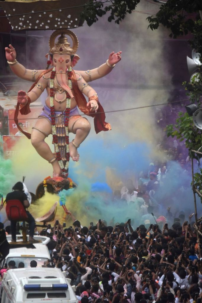 Devotees participate during the Lord Ganesh idol immersion rally at Lalbaug in Mumbai on Sep 12, 2019.