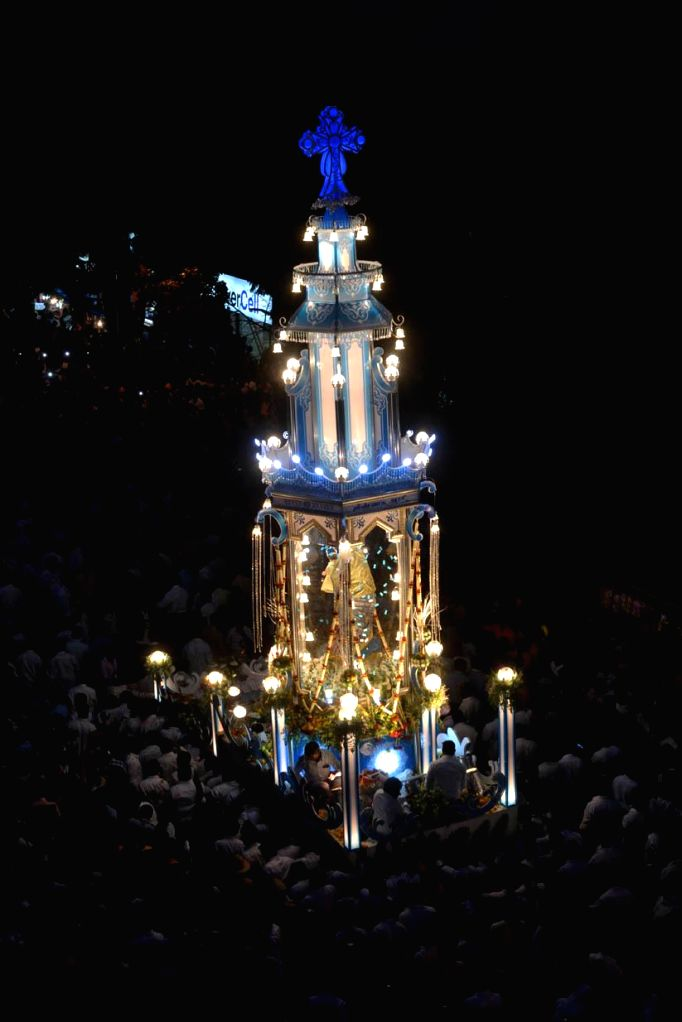 Devotees participate in a chariot procession as they celebrate St Marys Annual Feast 2014 at St Mary's Basilica Church in Bangalore on Sept 8, 2014.