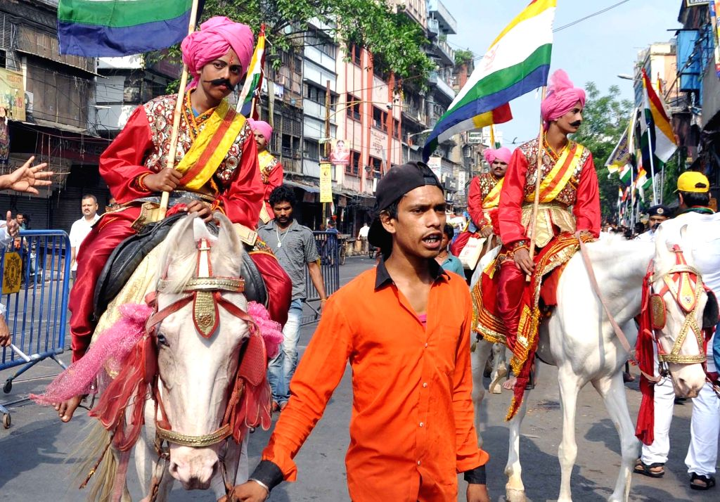 Devotees participate in a procession organised on Mahavir Jayanti, in Kolkata on March 29, 2018.