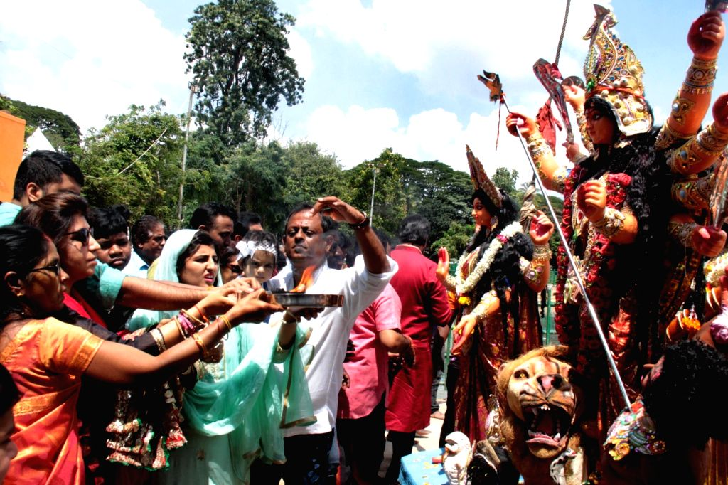 Devotees participate in a procession proceeding to Ulsoor Lake for the immersion of the idol of Goddess Durga on Vijay Dashmi, in Bengaluru on Oct 8, 2019.