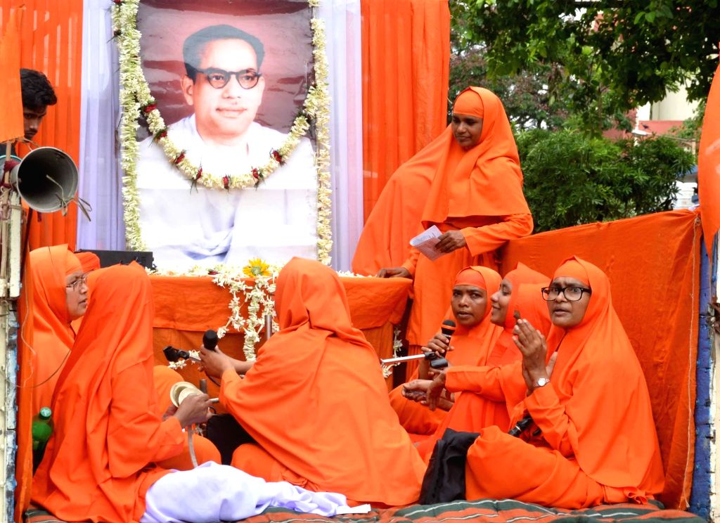 Devotees participate in a rally commemorating 96th birth celebration of Anandamurti organized by Ananda Marga in Kolkata on May 21, 2014.