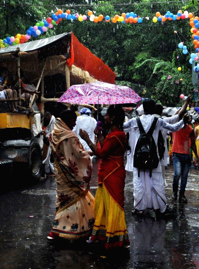 Devotees participate in a rath yatra organised by ISKCON in Kolkata, on June 25, 2017.