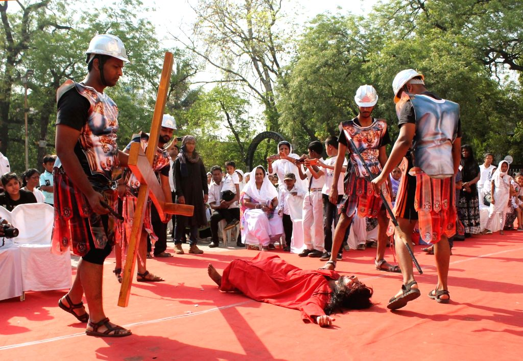 Devotees participate in a re-enactment of crucifixion of Jesus Christ on Good Friday in Nagpur on April 30, 2018.