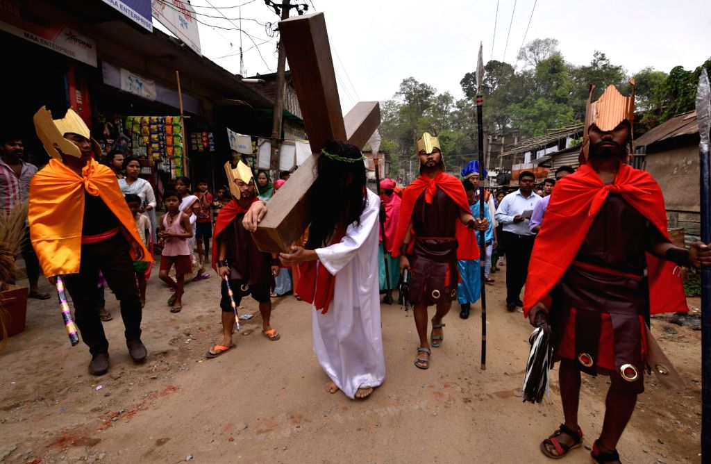 Devotees participate in a re-enactment of crucifixion of Jesus Christ on Good Friday in Guwahati on March 30, 2018.