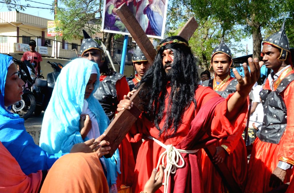 Devotees participate in a re-enactment of crucifixion of Jesus Christ on Good Friday in Bhopal on March 30, 2018.