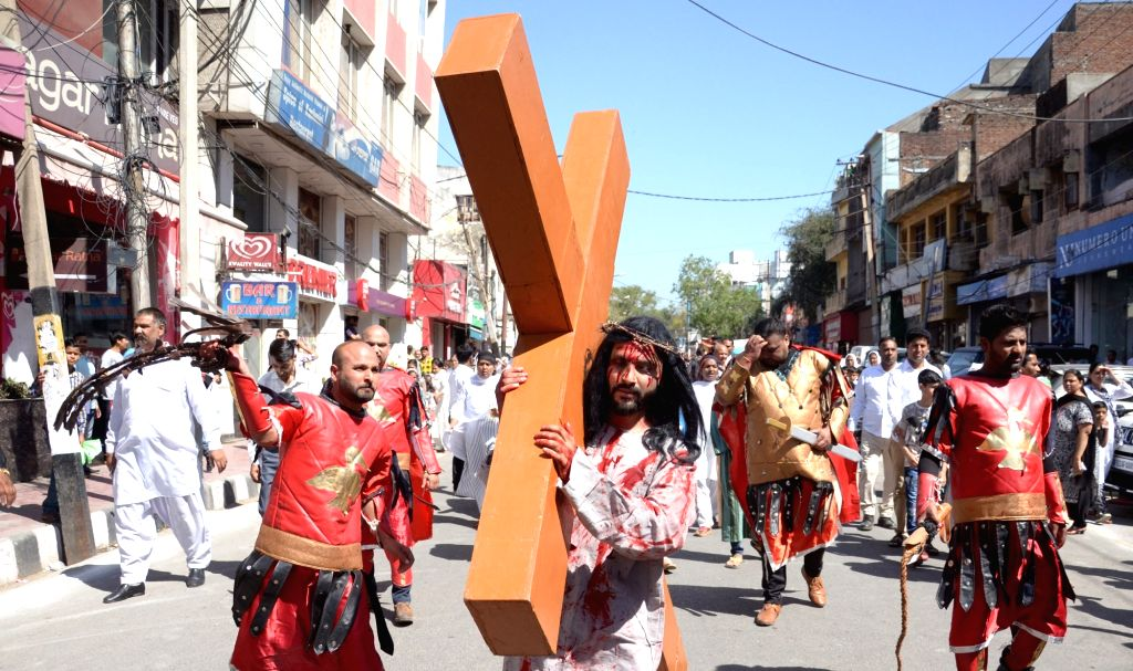 Devotees participate in a re-enactment of crucifixion of Jesus Christ on Good Friday in Jammu on March 30, 2018.