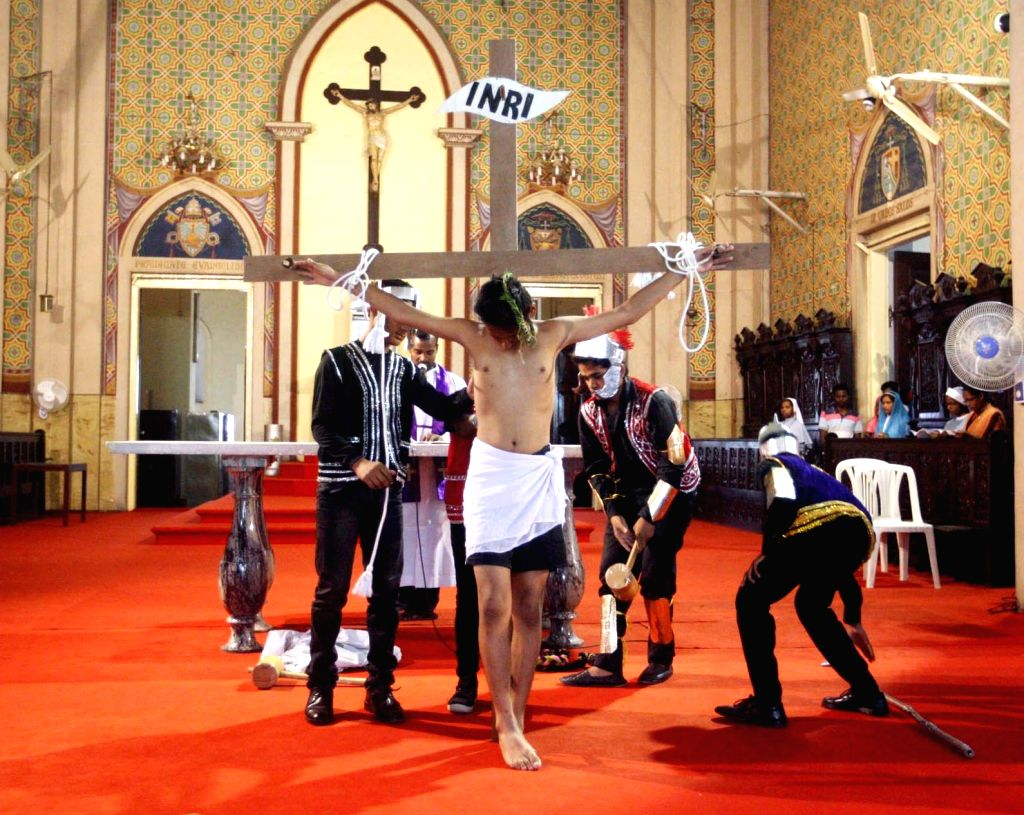 Devotees participate in a re-enactment of crucifixion of Jesus Christ on Good Friday in Allahabad on March 30, 2018.