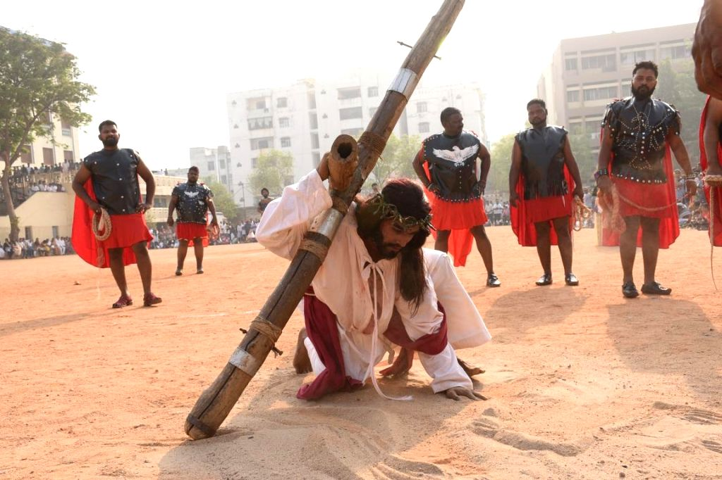 Devotees participate in a re-enactment of crucifixion of Jesus Christ on Good Friday in Hyderabad on March 30, 2018.
