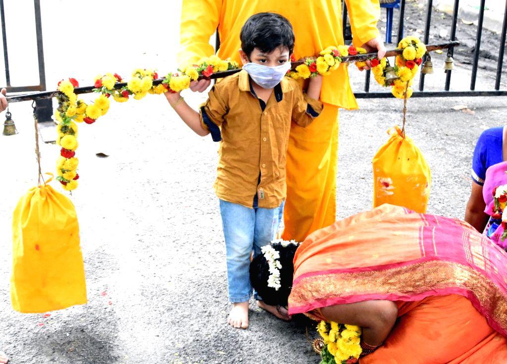 Devotees participate in 'Aadi Krithigai' celebrations amid COVID-19 pandemic, in Bengaluru on Aug 12, 2020.