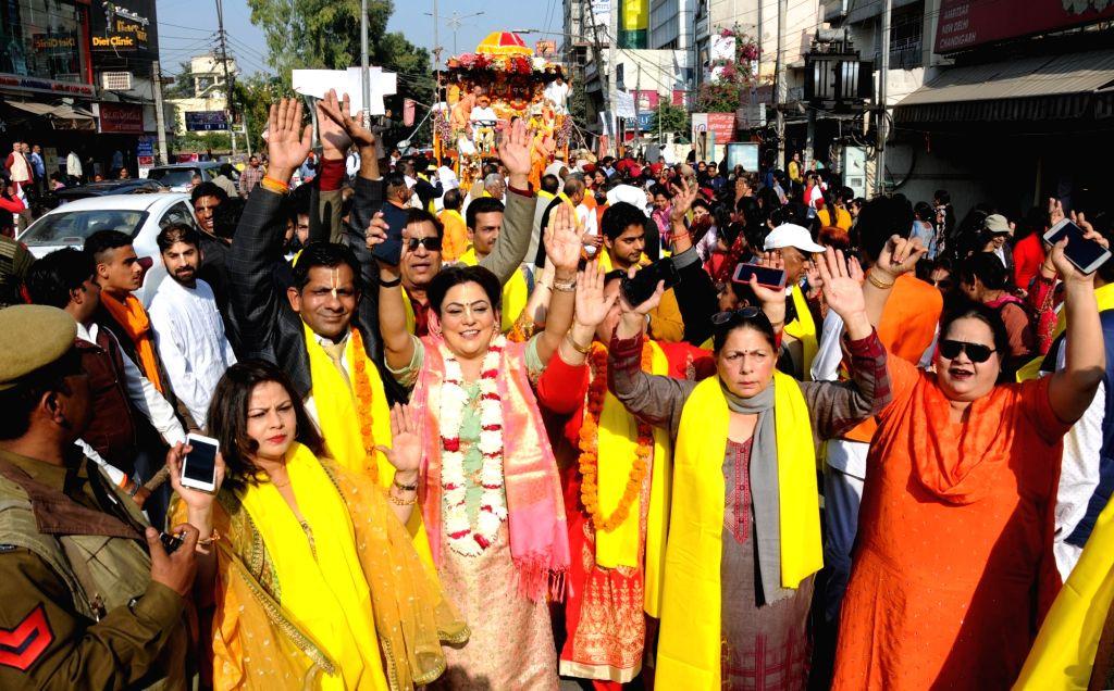 Devotees participate in Jagannath Rath Yatra organised by ISKCON Temple in Amritsar, on Dec 1, 2018.