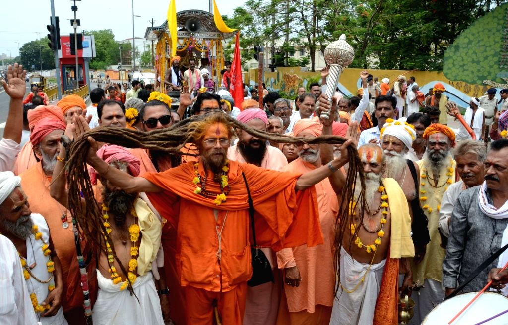Devotees participate in Lord Jagannath's annual rath yatra in Bhopal on June 25, 2017.