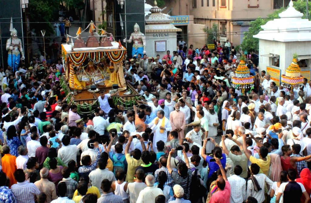 Devotees participate in Lord Jagannath's annual rath yatra in Mathura, on June 25, 2017.