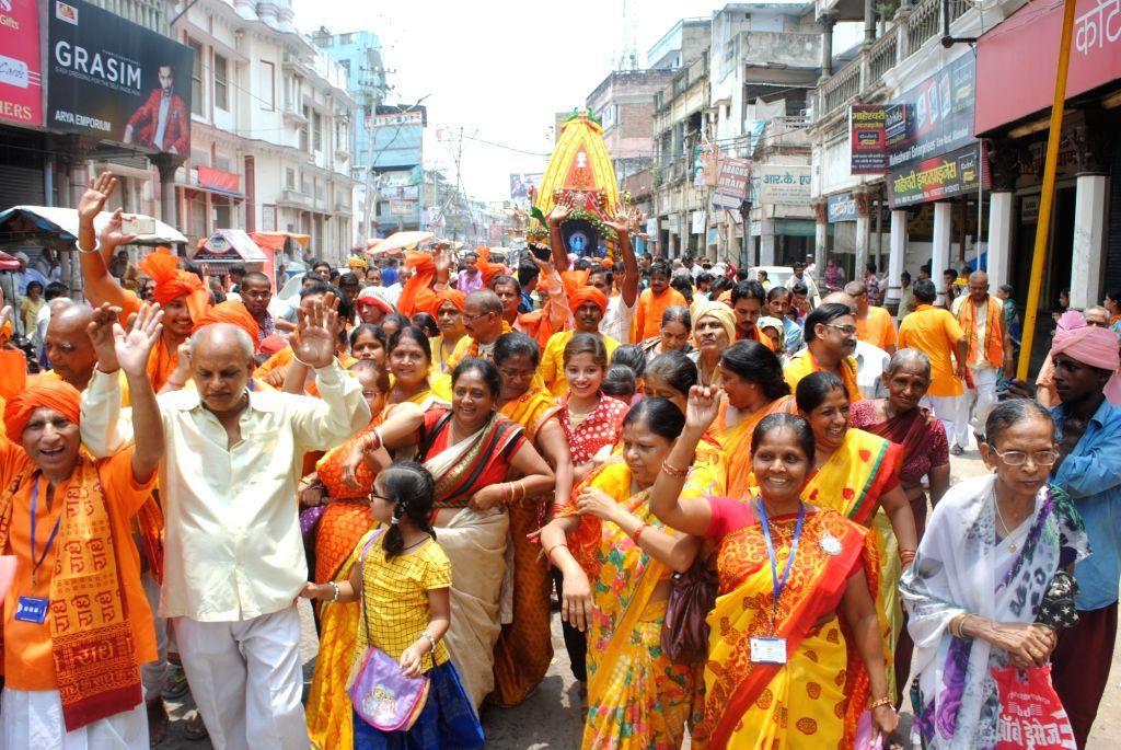 Devotees participate in Rath Yatra at Hatkeshwar Mahadev temple in Allahabad, on June 25, 2017.