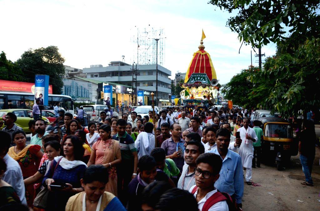 Devotees participate in Rath Yatra organised by ISKCON in Guwahati, on June 25, 2017.