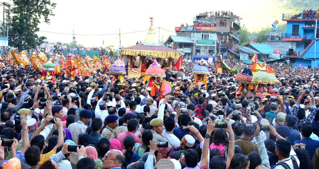 Devotees participate in Rathyatra of Lord Raghunath at the inauguration of week-long international Kullu Dussehra festival, in Kullu on Oct 8, 2019.