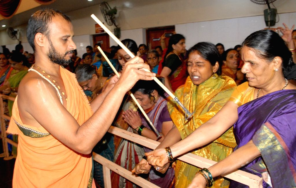 "Devotees participate in Tapta Mudraadharana on the occasion of ""Ekadashi"" at Uttaradi Mutt, in Bengaluru on July 15, 2016."