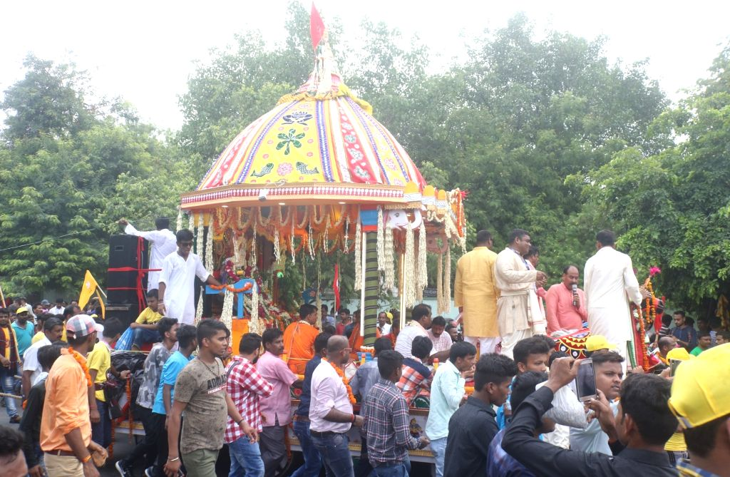 Devotees participate in the Jagannath Rath Yatra, in New Delhi on July 14, 2018. The Rath Yatra is an annual celebration, marking the annual journey of Lord Jagannath and his two siblings ...
