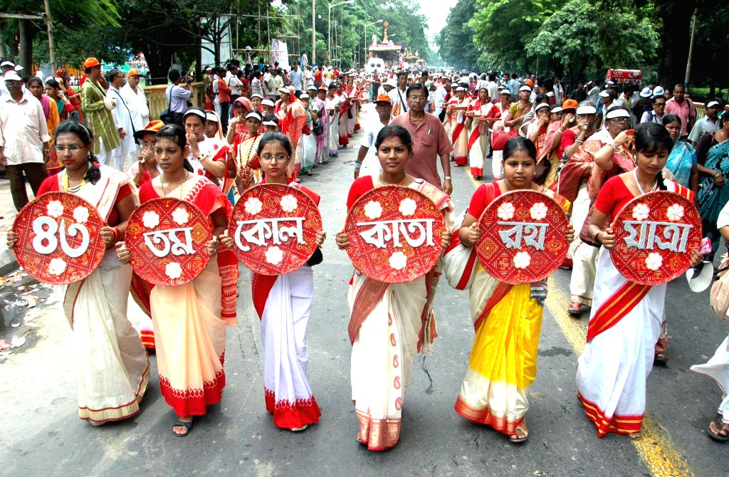 Devotees participate in Ulta RathYatra organised by International Society for Krishna Consciousness (ISKCON) in Kolkata on July 7, 2014.