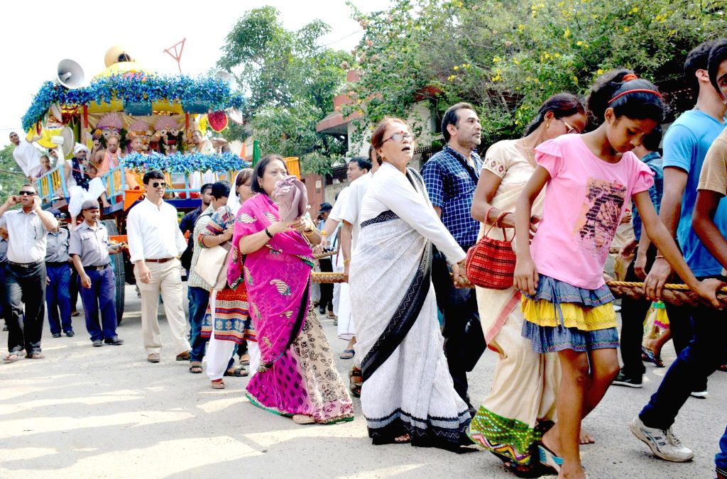 Devotees participate in Ulta RathYatra organised by International Society for Krishna Consciousness (ISKCON) in Guwahati on July 7, 2014.