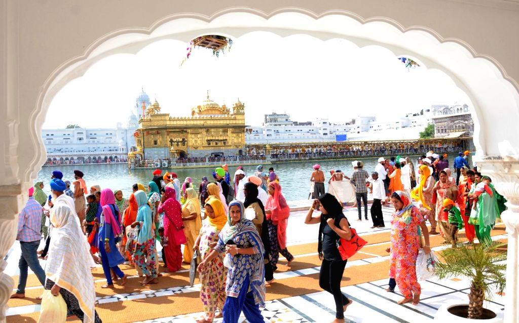 Devotees pay obeisance at the Golden Temple on the occasion of the fourth Sikh Guru Ramdas' birth anniversary in Amritsar, on Oct 17, 2016.