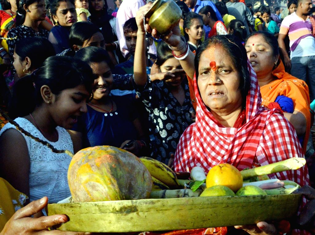 Devotees perform Chaiti Chhath ritual on the banks of the river Ganga in Patna, on April 13, 2016.