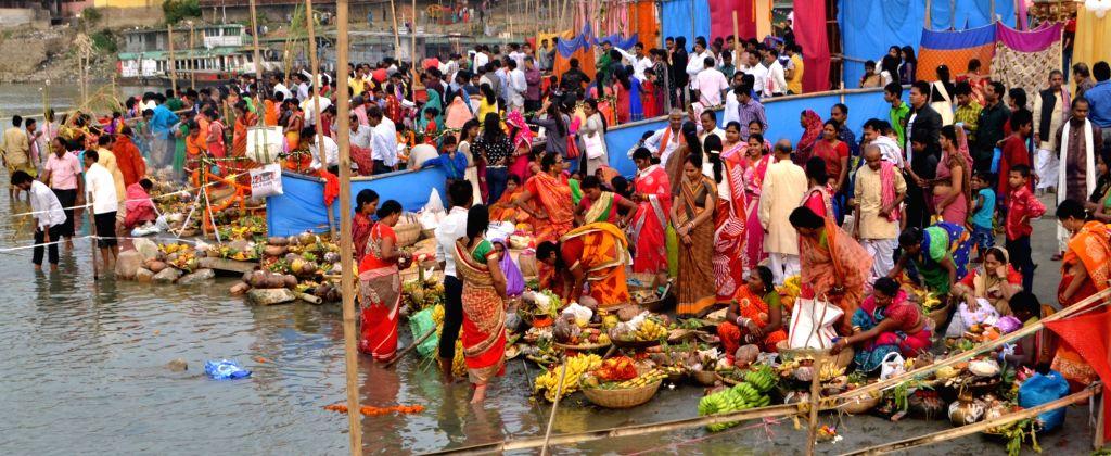 Devotees perform Chhath ritual on the banks of the river Brahmaputra in Guwahati on Nov 17, 2015.