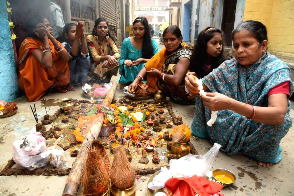 Devotees perform rituals as they perform 'puja' to pray for the long life of their brothers during 'Bhai Dooj' celebrations in Patna on Nov 16, 2020.