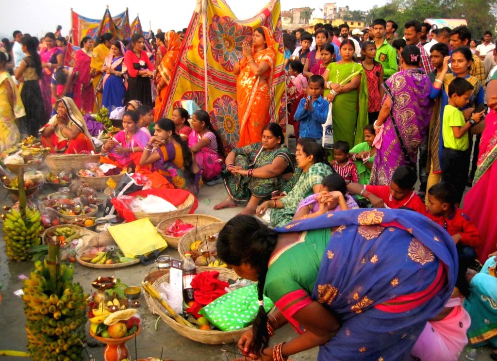 Devotees perform rituals at the time of sunset during Chhiti Chath Puja, at river Brhmaputra in Guwahati on April 12, 2016.