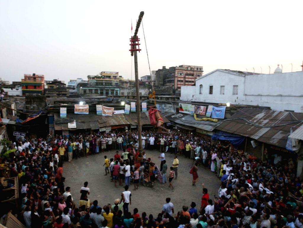 Devotees perform rituals during `Charak` celebrations in Kolkata on April 13, 2016.