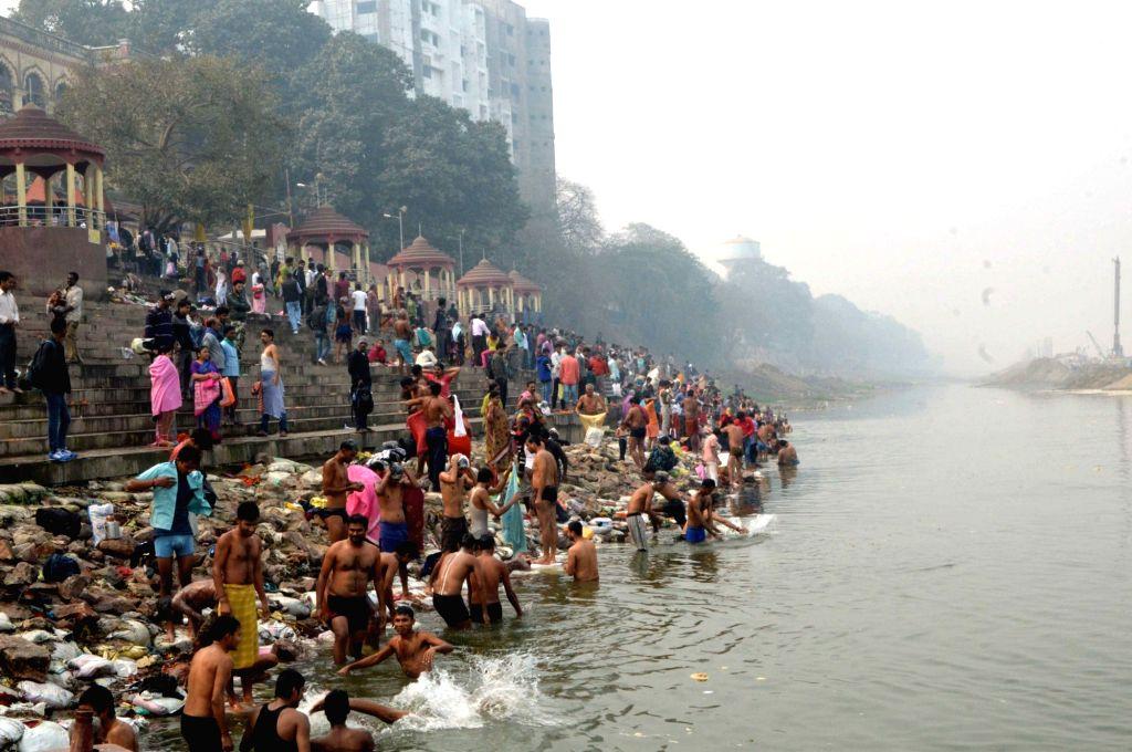 Devotees perform rituals on the banks of the Ganga river on Makar Sankranti in Patna, on Jan 15, 2016.