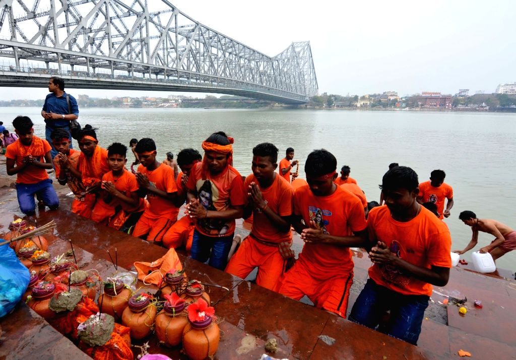 Devotees perform rituals on the eve of Maha Shivratri festival in Kolkata, on  March 3, 2019.