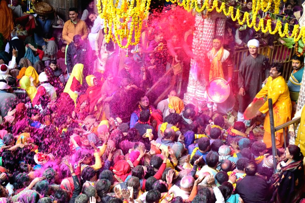 Devotees play with colour powders at the Banke Bihari Temple Vrindavan during a programme organied to mark the beginning of the 40-day-long Holi Mahotsav in Mathura on Feb 10, 2019.