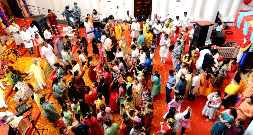 Devotees play with flower petals called 'Phool Dol' or Holi celebrations at Ganesh temple in Kolkata on March 29, 2021