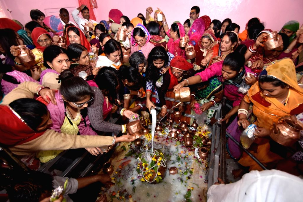 Devotees pour water and milk over the Shiv Linga as they perform rituals on the occasion of Maha Shivaratri in Jaipur on Feb 13, 2018.