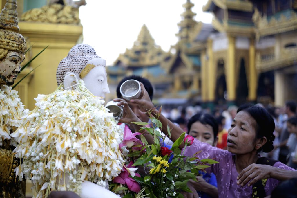 Devotees pour water over a Buddha statue on Myanmar's traditional Tazaungdaing Festival at the Shwedagon Pagoda in Yangon, Myanmar, Nov. 26, 2015. The Tazaungdaing ...