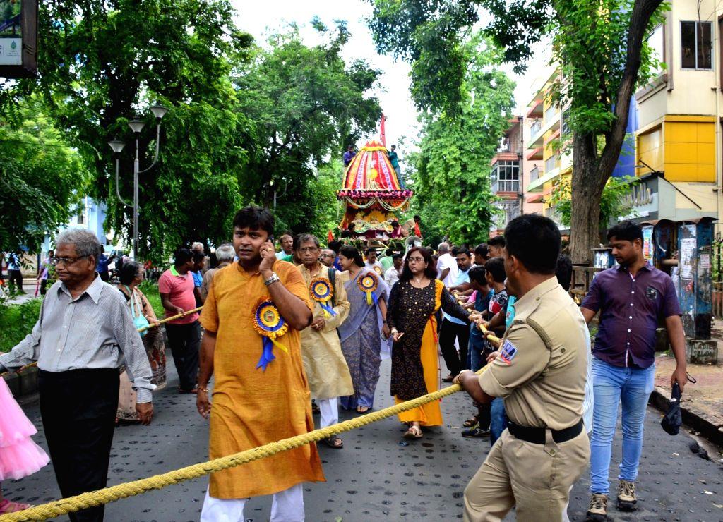 Devotees pull a chariot during Jagannath Rath Yatra, in Kolkata on July 14, 2018.